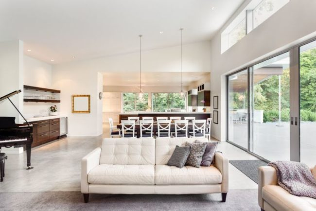45169189 - beautiful living room in new luxury home with view of dining room table and kitchen