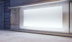 50928741 - large blank banner in a shop window at night, mock up