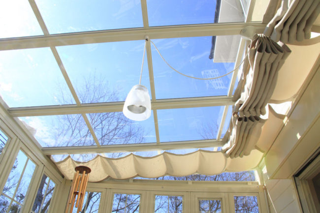 47184821 - blue sky visible from the sunroof of the conservatory