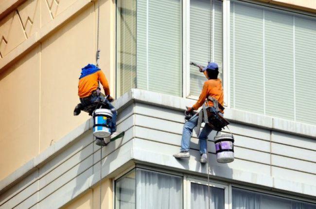 11864274 - two men washes skyscraper's facade