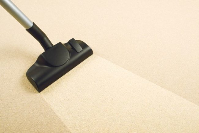 30872324 - vacuum cleaner sweeping brand new carpet  housework and home hygiene