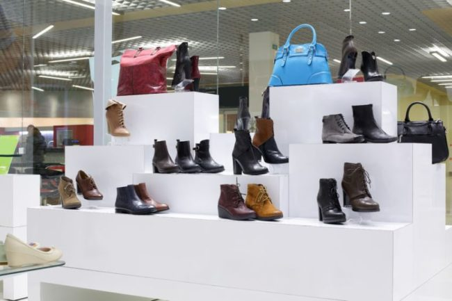 34260281 - bright and fashionable interior of shoe store in modern mall